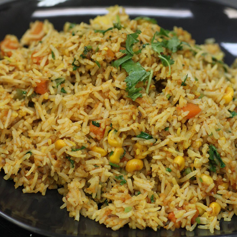 Veggie Biryani Served with Lazeez Raita